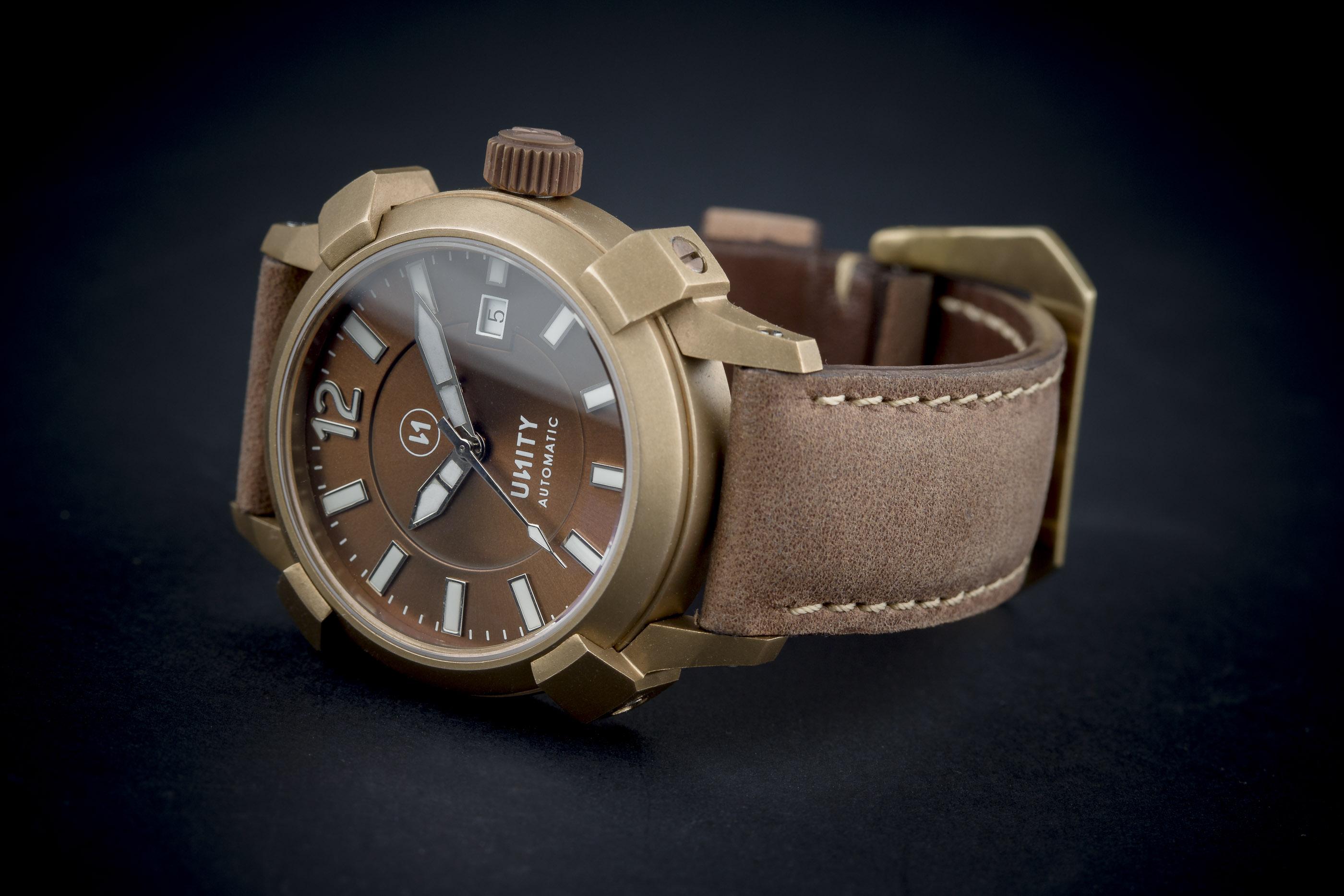 reloj bronce marron