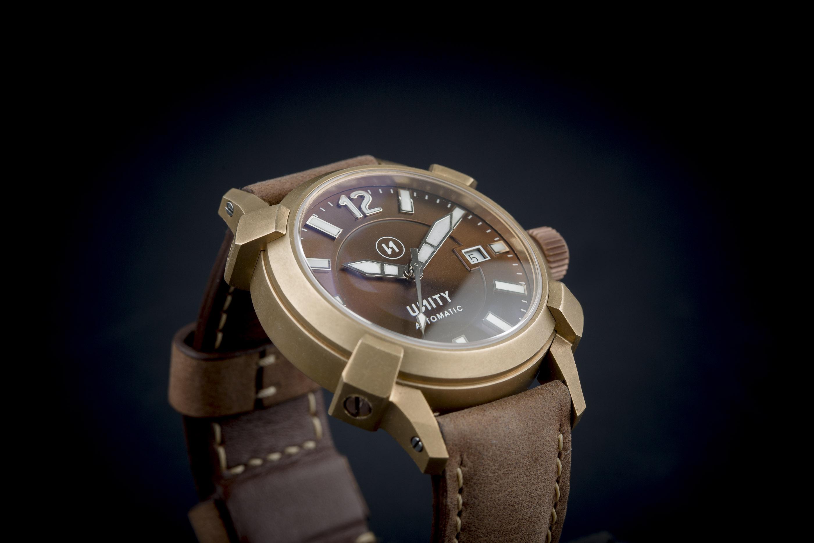 reloj bronce unity