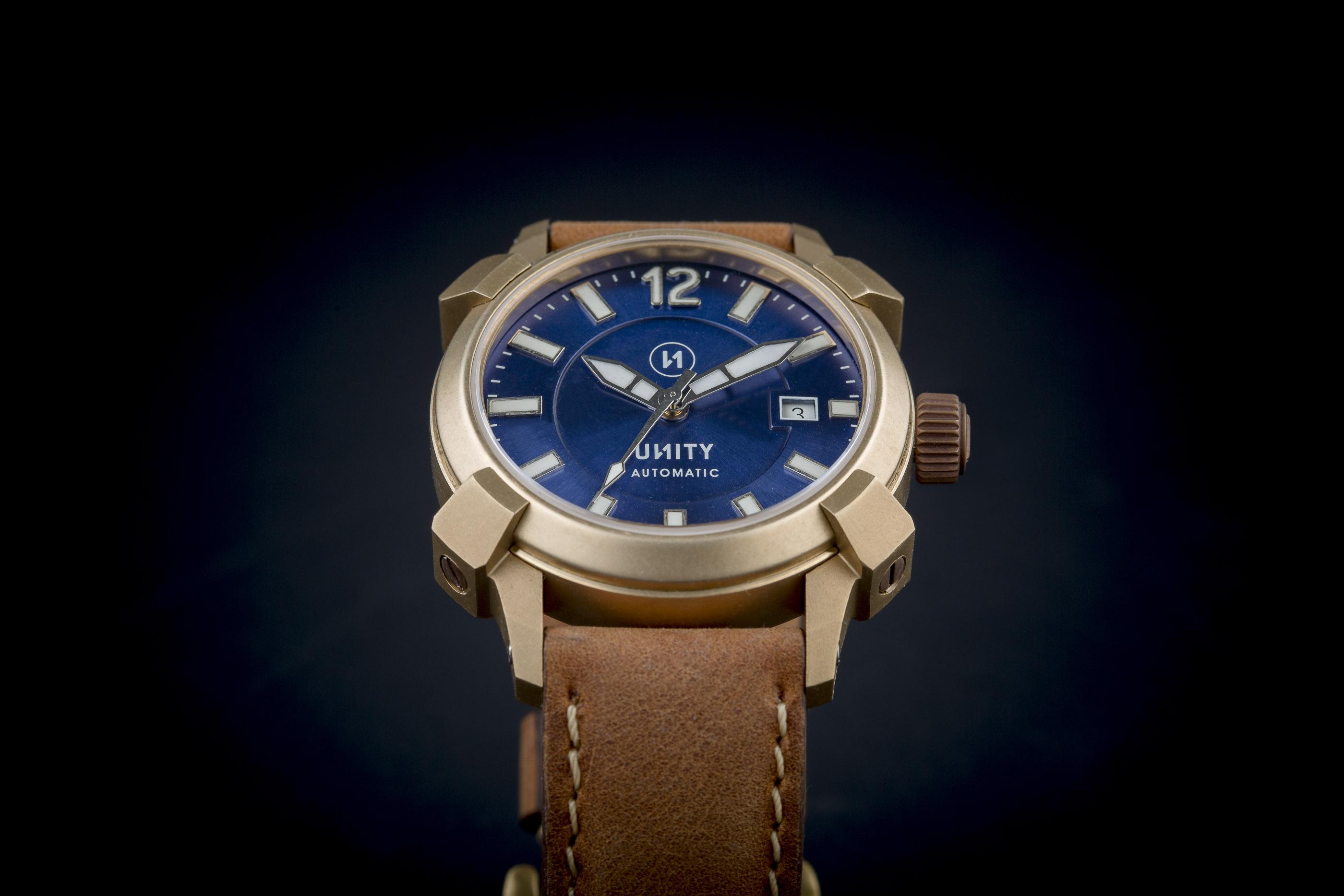 unity reloj exclusivo bronce